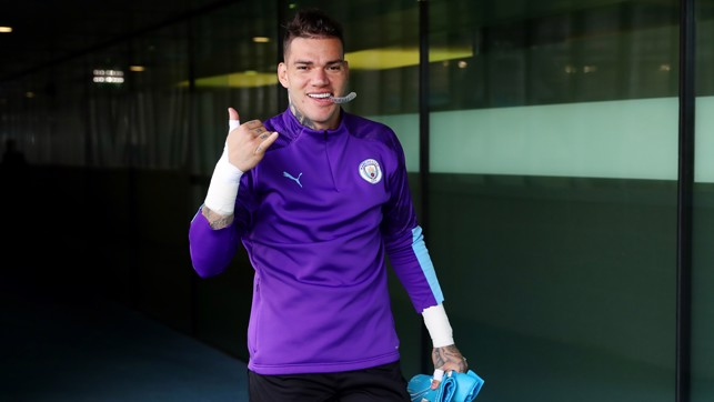 ALL SMILES : Ederson heads out for training.