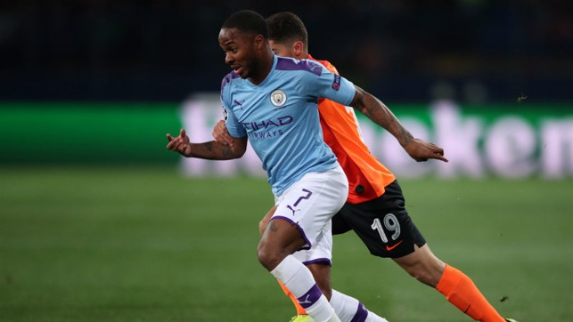 ON THE MARCH : Raheem Sterling takes on the Shakhtar defence
