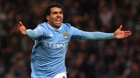 ON TARGET: Carlos Tevez celebrates his winner against Chelsea in 2009.