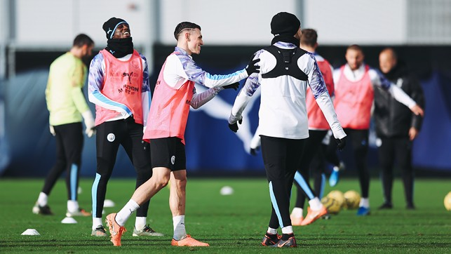 PHIL-ANTHROPY : Phil Foden shares a joke with his teammates