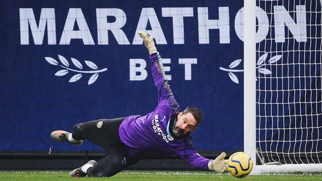 AT FULL STRETCH : Scott Carson dives to keep out a low shot