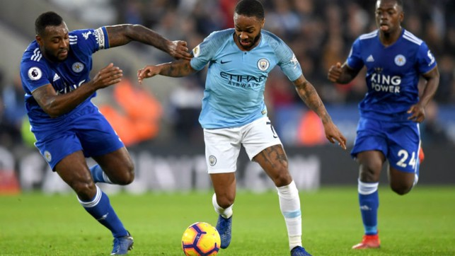 CENTRE OF ATTENTION : Raheem Sterling takes on Wes Morgan
