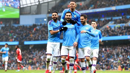 GUNDO-GOAL: The players mob Gundogan after his opener from the penalty spot.