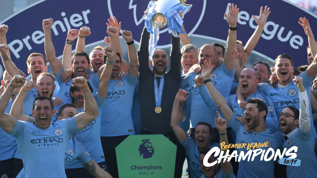 WE DID IT! Pep Guardiola lifts the trophy aloft_