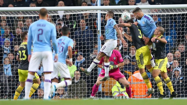 NO STOPPING HIM : Nicolas Otamendi rises highest to power home the opening goal.