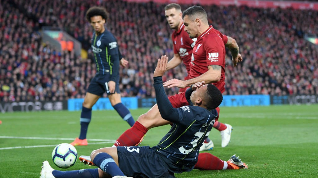OUCH : Gabriel Jesus feels the force of a Dejan Lovren challenge