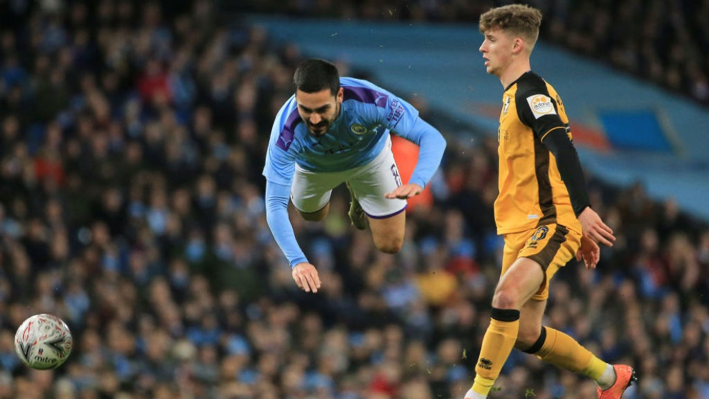 FLYING HIGH : Ilkay Gundogan takes a tumble as the FA Cup action hots up