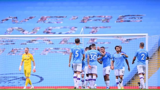 DEJA VU : The players gather to celebrate again after Jesus' impressive strike.