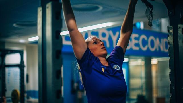 REACH FOR THE SKY : Gemma Bonner tests her upper body strength