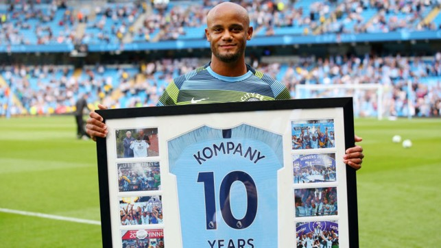 DECADE : Vincent Kompany received his gift for 10 years at the club before kick-off.
