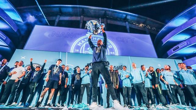 SKIPPER : Vincent Kompany lifts the trophy aloft.