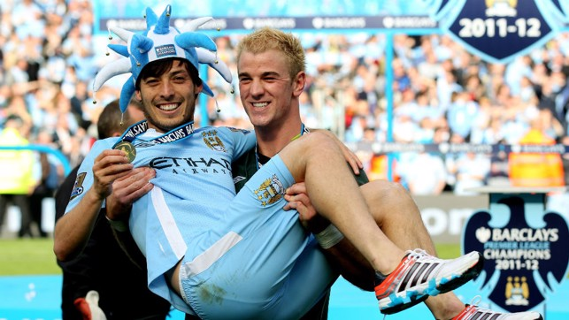 THE MAGICIAN : Hart celebrates the 2011/12 title win with David Silva.