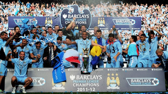 SPOT SILVA : Can you see our Spanish midfielder after we won the 2011/12 Premier League, a clue - he is sporting some fancy headgear.