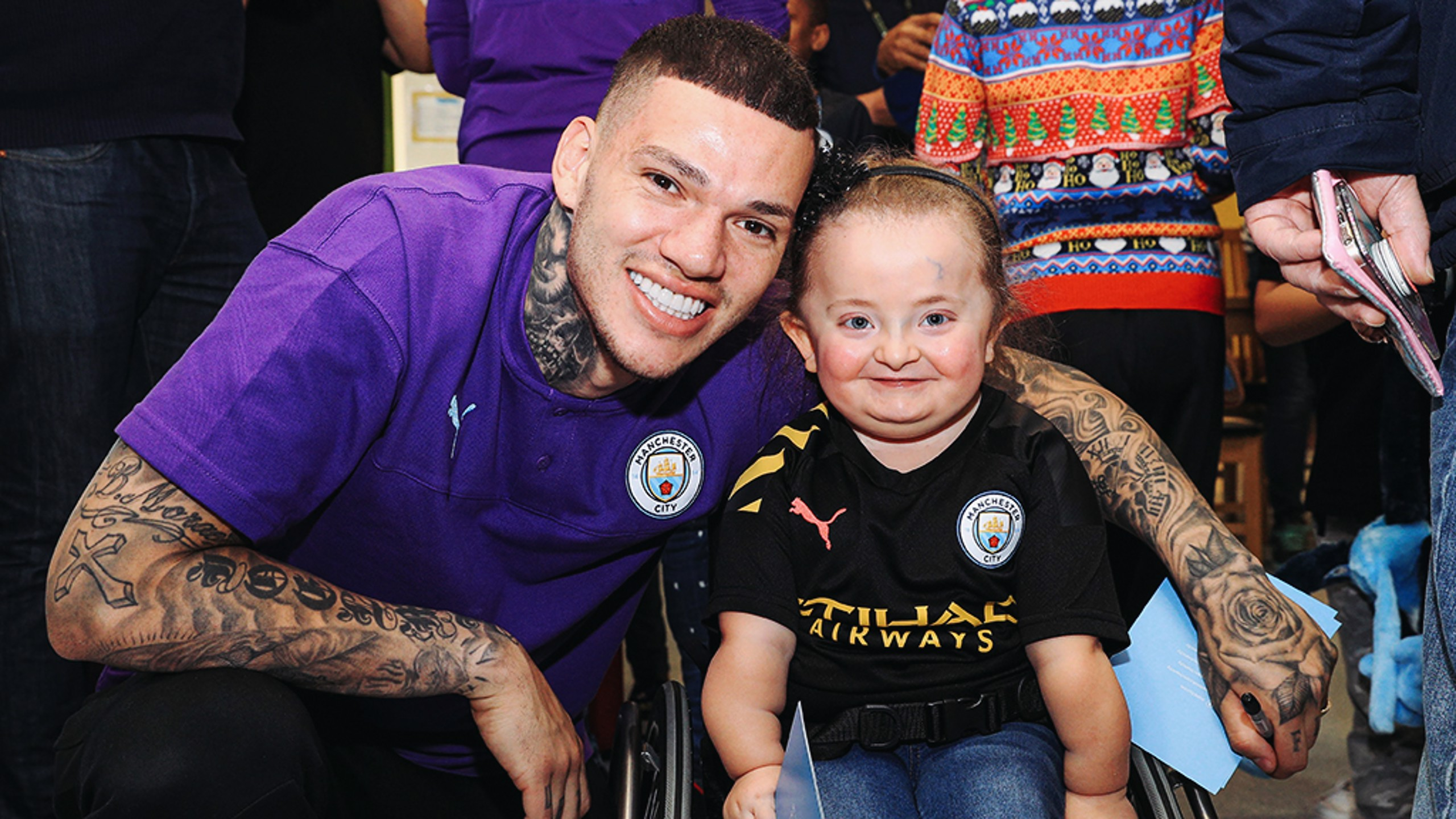 ALL SMILES: Ederson shares a special moment with one brave young patient