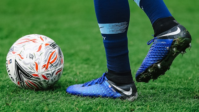 BIG BOOTS TO PHIL : Young Foden shows off his custom footwear
