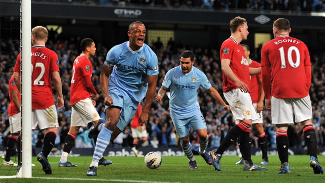 CAPTAIN KOMPANY : The skipper heads City to a 1-0 win against Manchester United in 2012