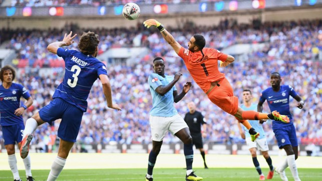 HELPING HAND : Claudio Bravo leaps high to avert the danger from a Chelsea attack