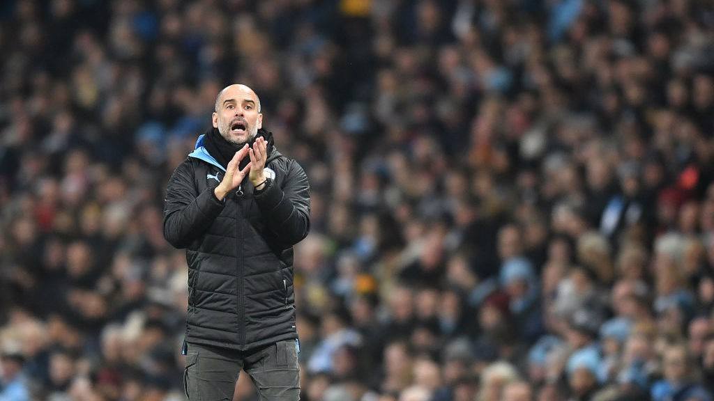 THE BOSS : Guardiola shouts his instructions from the touchline