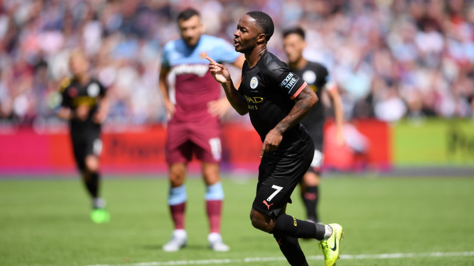 UNSTOPPABLE: Raheem Sterling wheels away after netting his second and City's third.