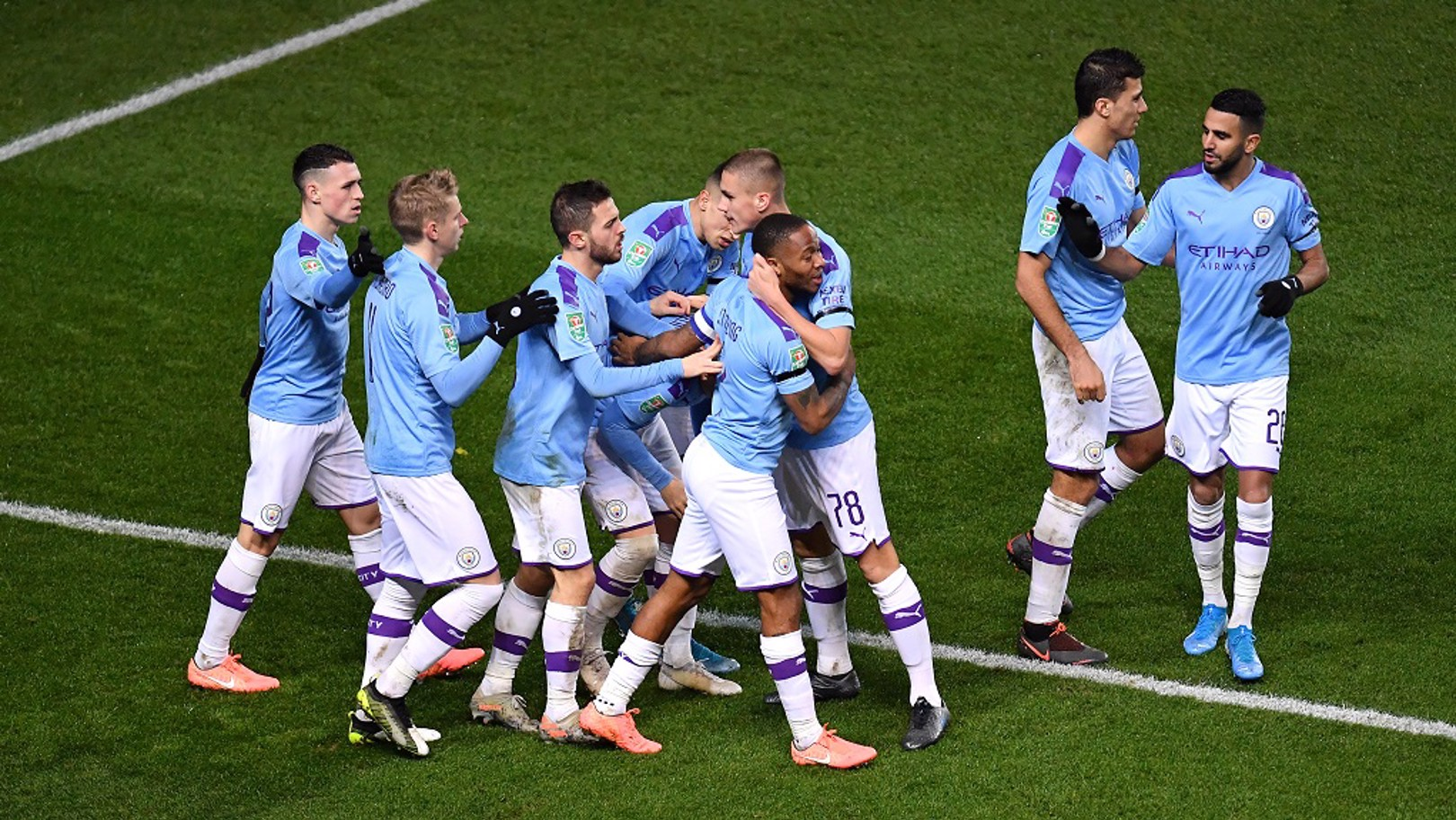 TEAMWORK: Raheem is congratulated on his 17th of the season and City's 100th League Cup goal this decade