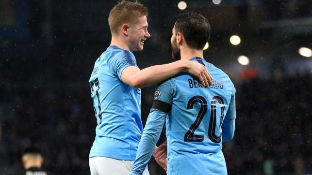 DOUBLE TROUBLE : KDB and Bernardo celebrate City's second.