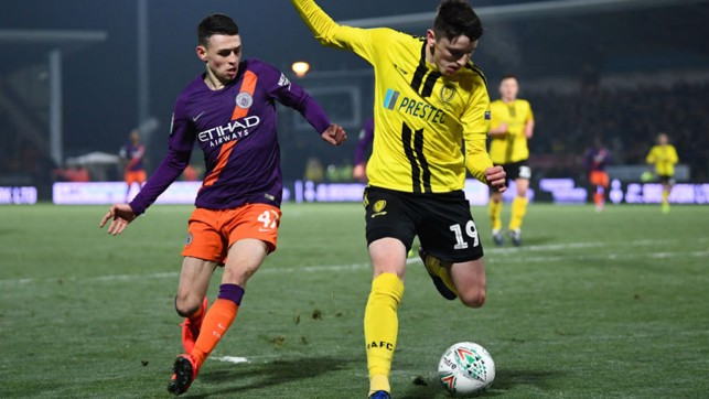 PRESSING HARD : Phil Foden looks to win possession in a dangerous area