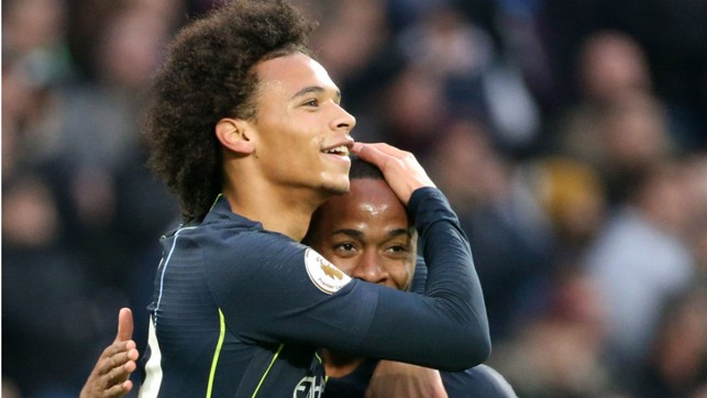 CITY SLICKERS : Leroy Sane and Raheem Sterling celebrate after City's second goal