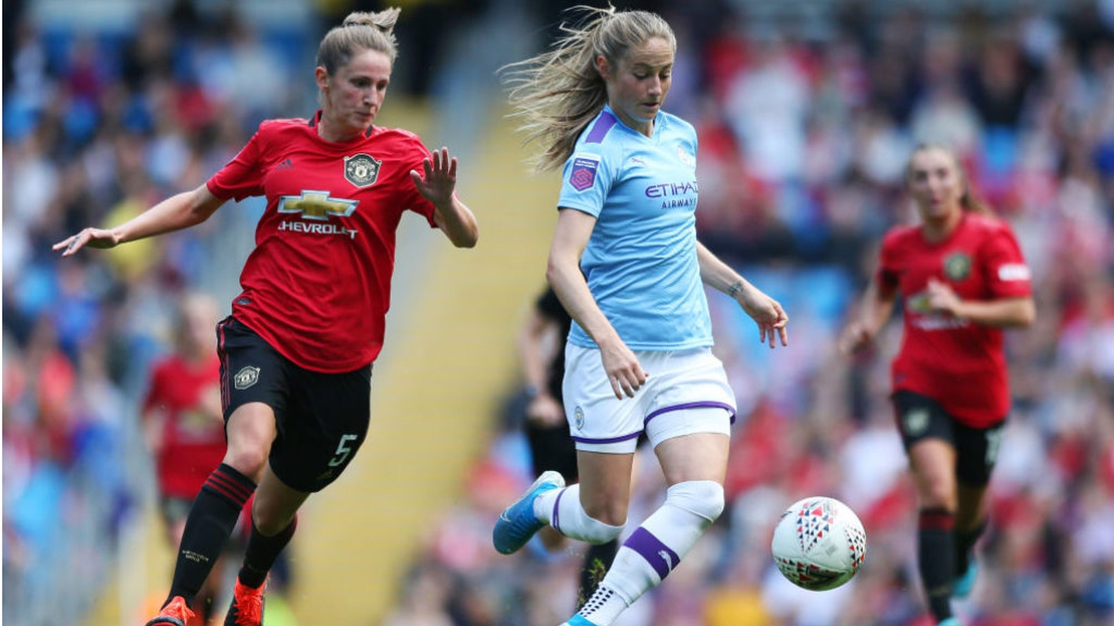 FORWARD MARCH: Janine Beckie in action during last month's historic derby clash with Manchester United