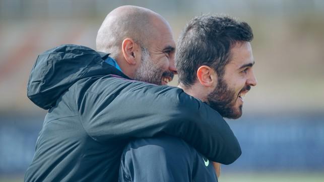 SMILES ALL ROUND : Pep Guardiola and Bernardo Silva share a laugh