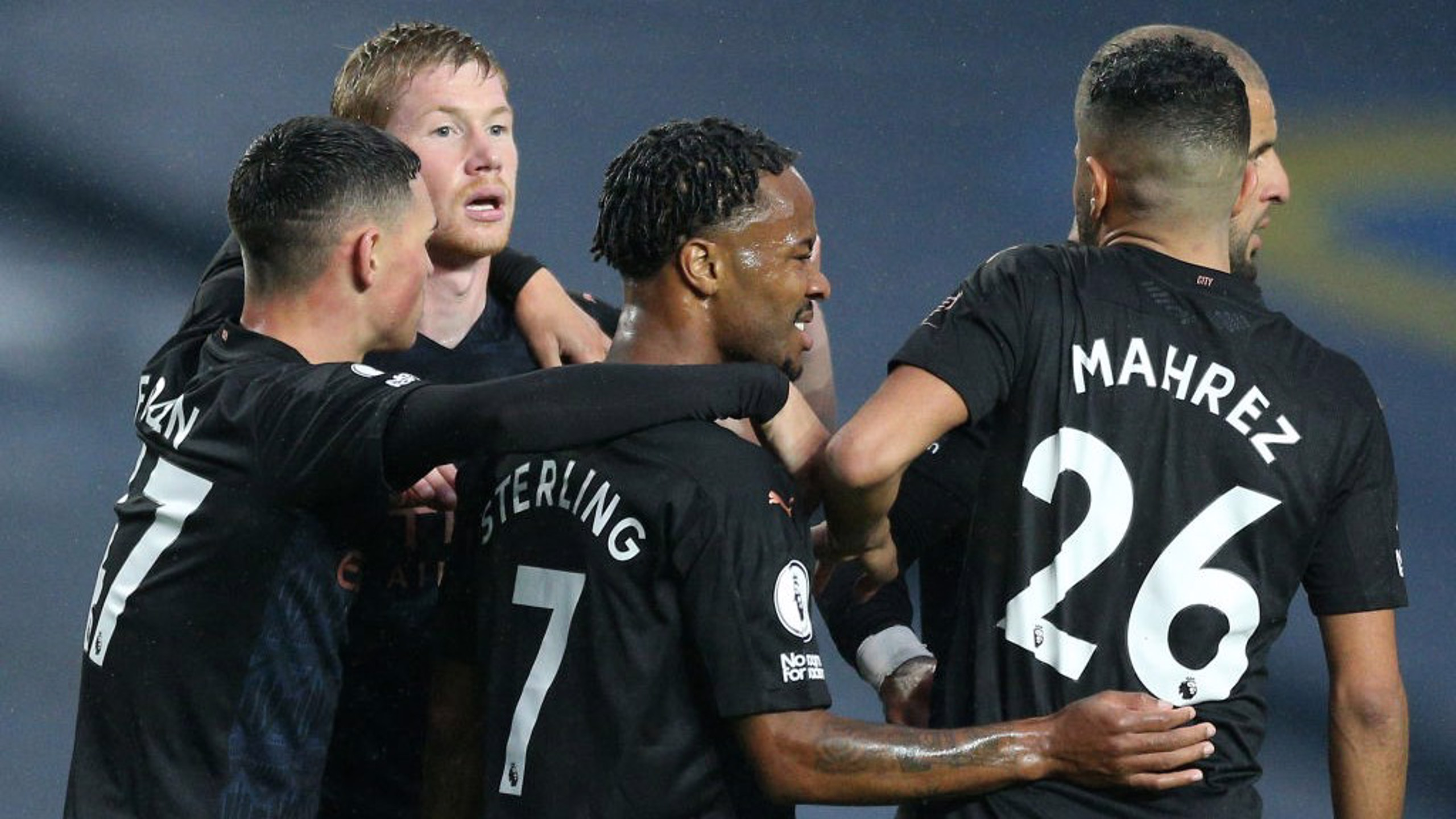 BRIGHT START: The lads congratulate Raheem after he opens the scoring