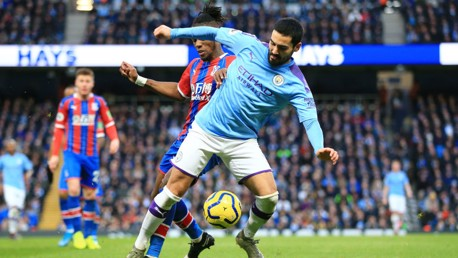 BATTLE: Gundogan tries to evade the attention of Zaha.