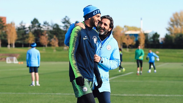 FUN AND GAMES : Fitness coach Lorenzo Buenaventura shares a smile with Riyad Mahrez