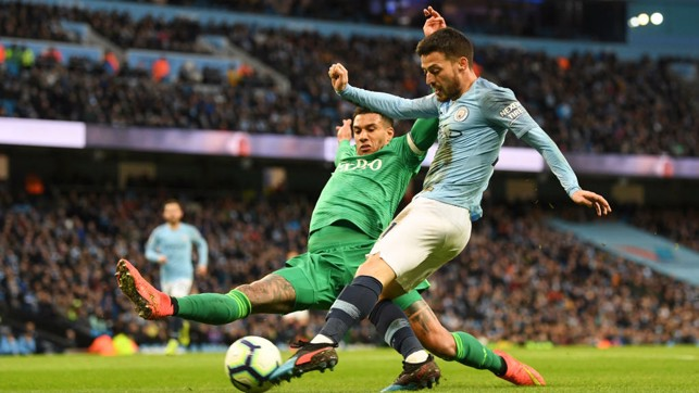 ALL FIRED UP : David Silva powers in a shot on goal