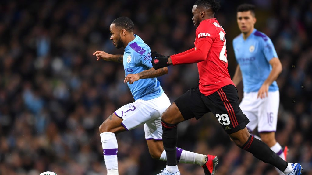 ACTION : _Sterling looks to escape the attention of Wan-Bissaka_
