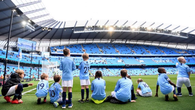 READY AND WAITING : Today's mascots prepare for the game