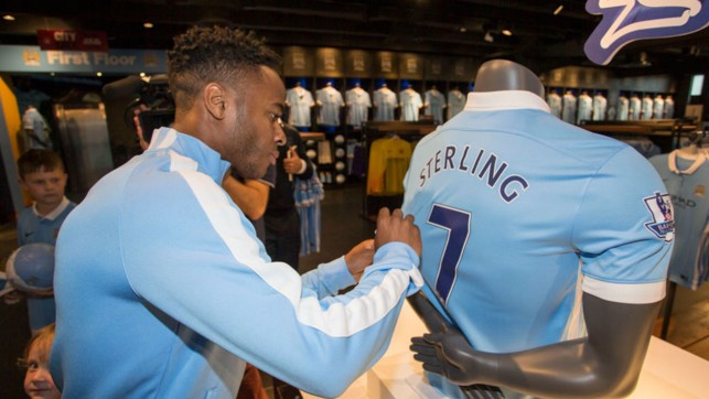 NEW RECRUIT : Sterling signs his jersey upon joining the club.