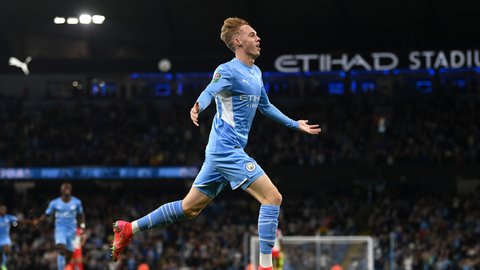 DRINK IT IN : Cole wheels away to take in the Etihad applause!