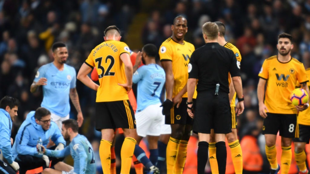 EARLY BATH : Willy Boly sees red for a crunching foul on Bernardo Silva