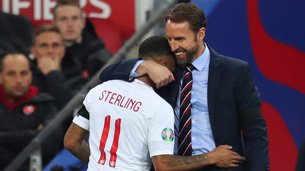 WELL DONE, SON! Gareth Southgate is delighted with Raheem's display