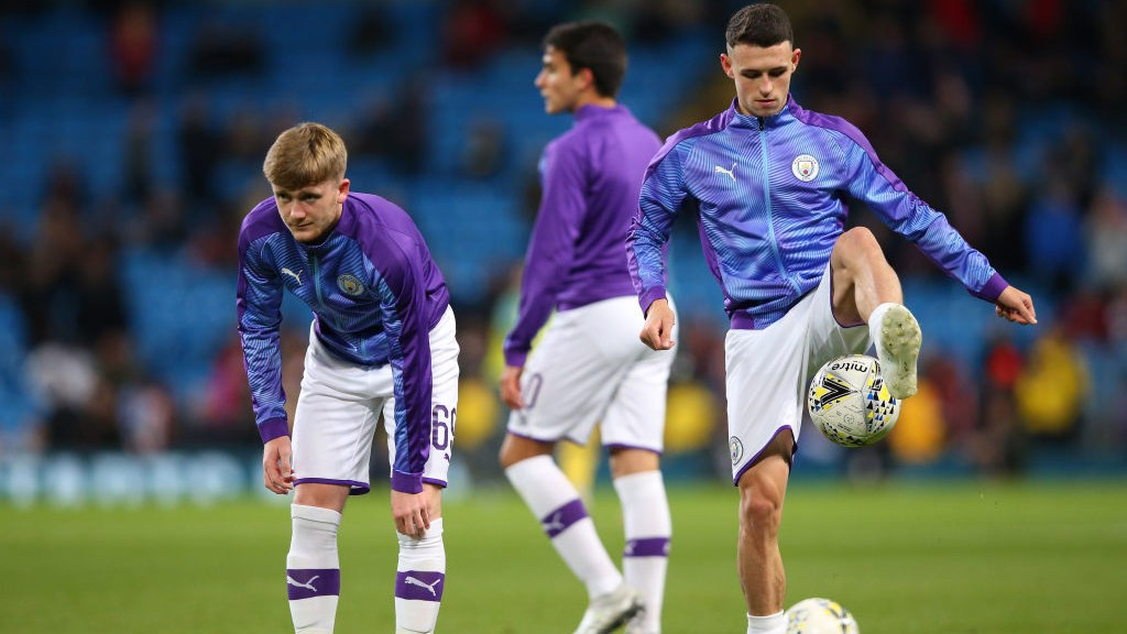 ACADEMY GRADUATES : Tommy Doyle, Phil Foden and Eric Garcia get set in the warm-up.