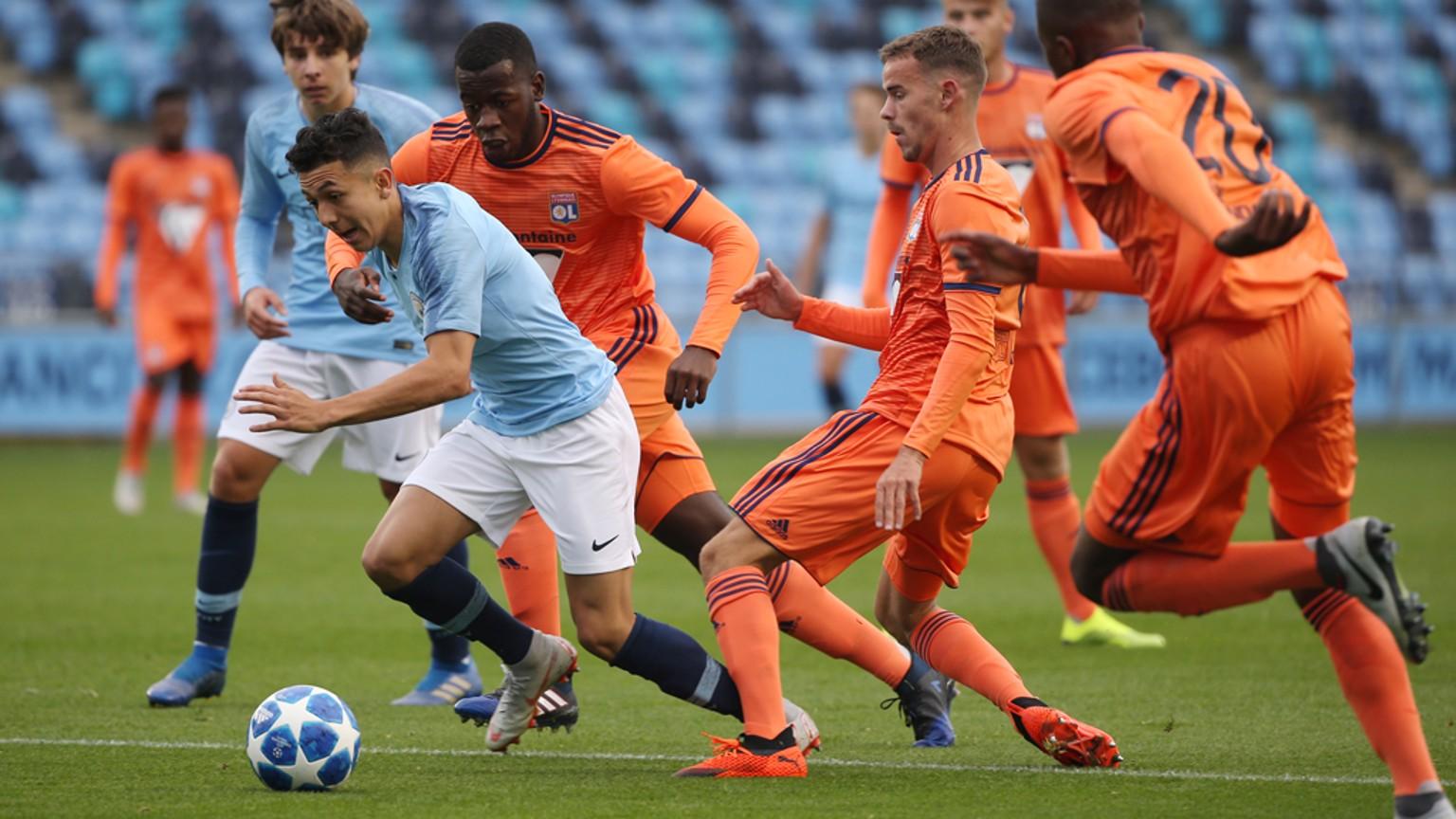 ACTION SHOT: Ian Poveda bursts through the Lyon defence.