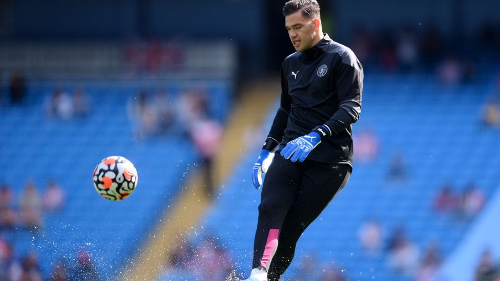 STEADY EDDIE : Our shot-stopper gets in the mood during the pre-match warm up.