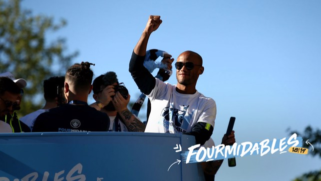 LEADER : Vincent Kompany salutes fans at the champions parade.