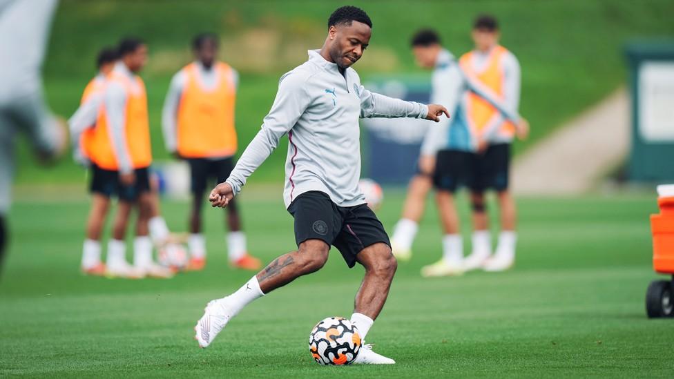 RAZZMATAZZ : Raheem Sterling puts his foot through the ball