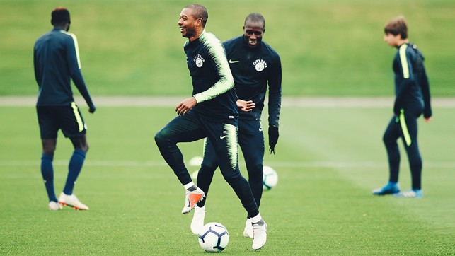 STEP TO IT : Fernandinho and Benjamin Mendy share a smile