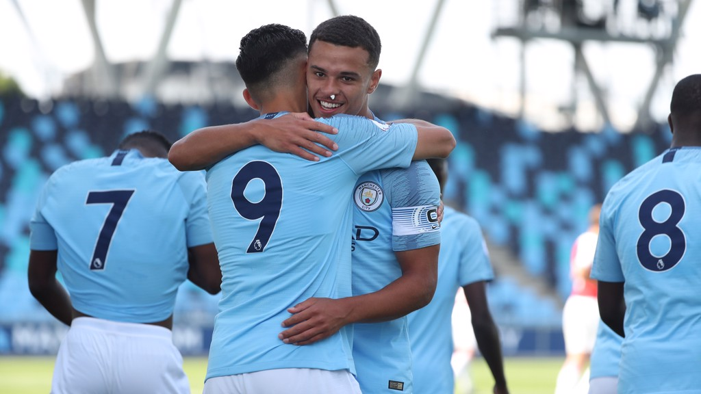 ELATION: City celebrate victory over Arsenal