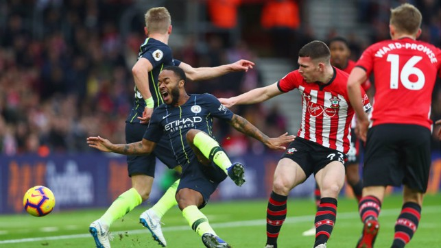 OUCH : Raheem Sterling is sent crashing by Pierre-Emile Hojbjerg