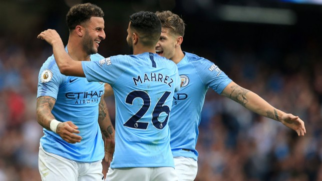 TRIO : Walker celebrates with John Stones and Mahrez after restoring our lead.