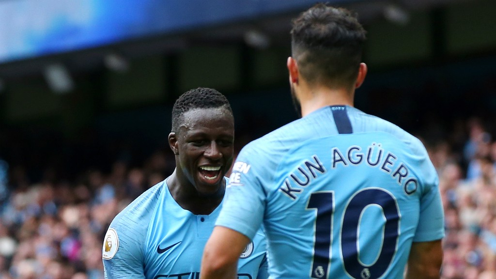 MERCI, MENDY! : Sergio Aguero thanks Benjamin Mendy for his assist, having completed his hat-trick with a glorious flick