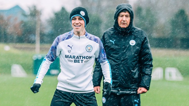 WET, WET, WET: That didn't stop Phil Foden from smiling!